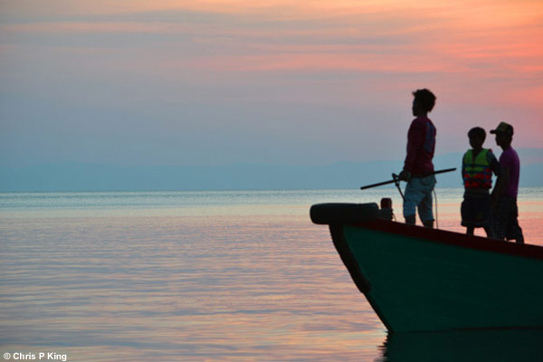 Boys on Boat off Rabbit Island (Koh Tonsay) Cambodia with Sunset