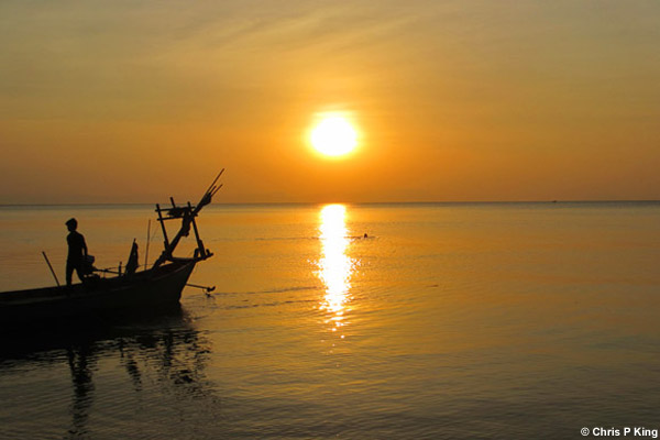 Golden Yellow Sunset and Boat from Rabbit Island (Koh Tonsay) Cambodia