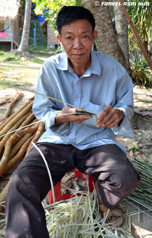 Man Making Beach Huts on Rabbit Island Cambodia