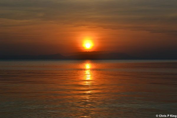 Sunset and Calm Sea with Phu Quoc in the Background Rabbit Island (Koh Tonsay) Cambodia