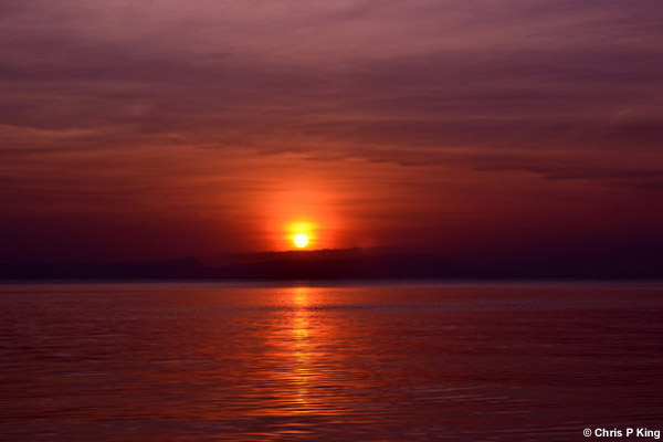 Sunset at Phu Quoc on a Copper Sea from Rabbit Island (Koh Tonsay) Cambodia