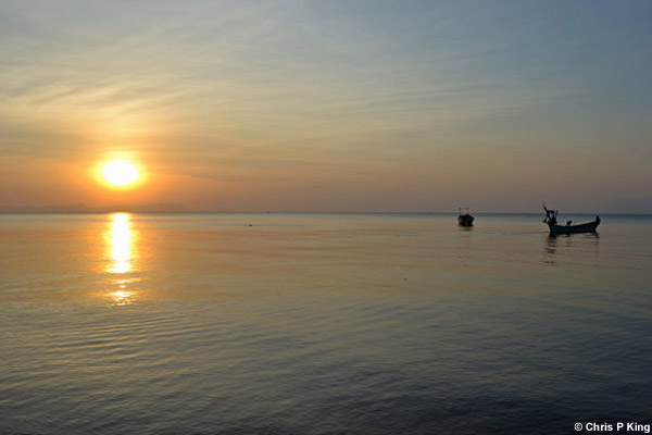 Sunset on Calm Sea with Boats Rabbit Island (Koh Tonsay) Cambodia