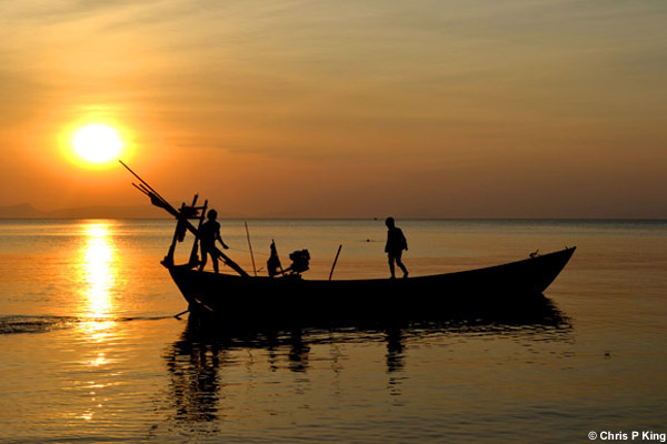 Sunset with boys on a Boat Rabbit Island (Koh Tonsay) Cambodia