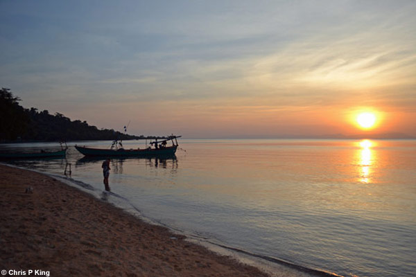 Sunset with View of Beach, Headland, Boats and Sea at Rabbit Island (Koh Tonsay) Cambodia